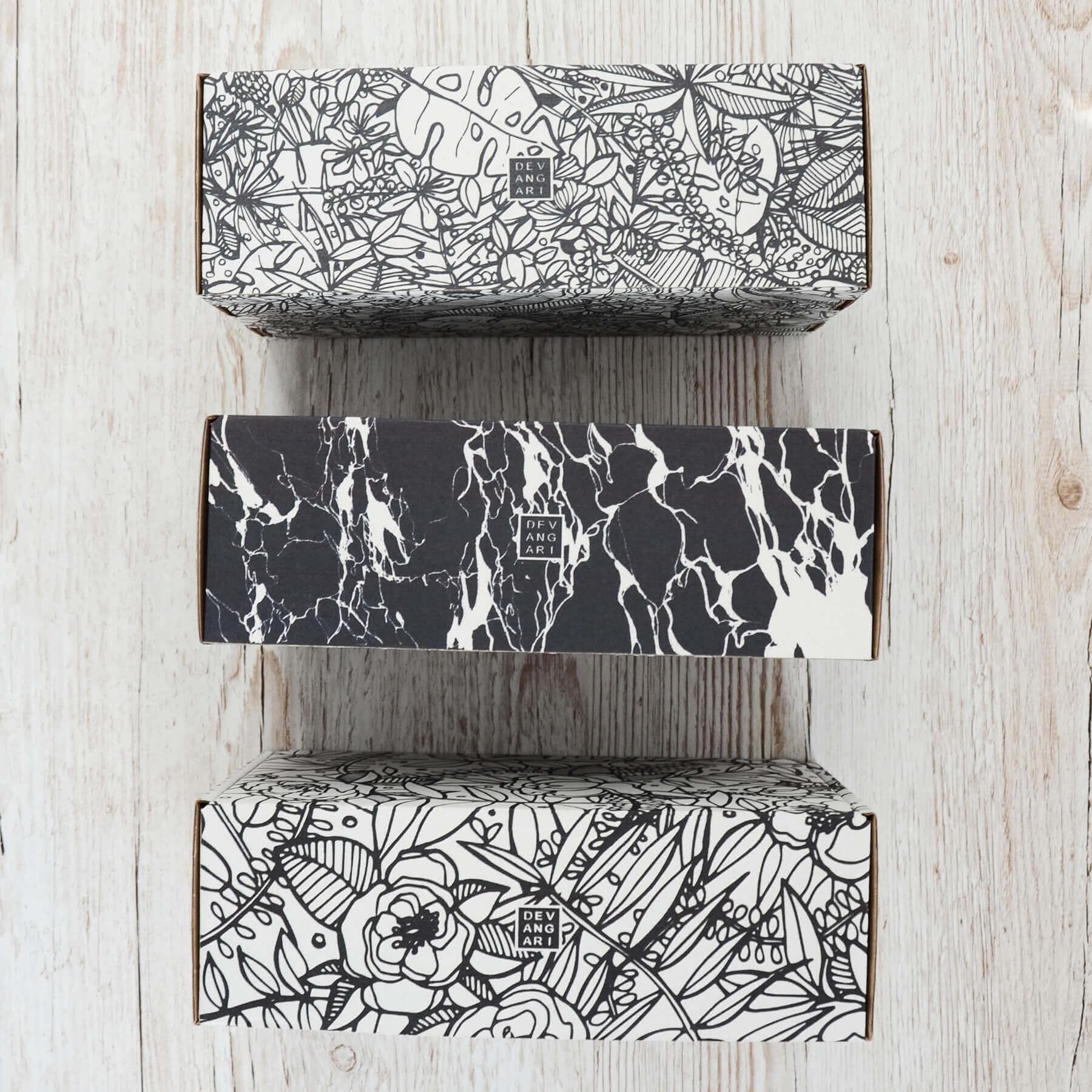 Boîtes de luxe stylisées façon marbre de Devangari