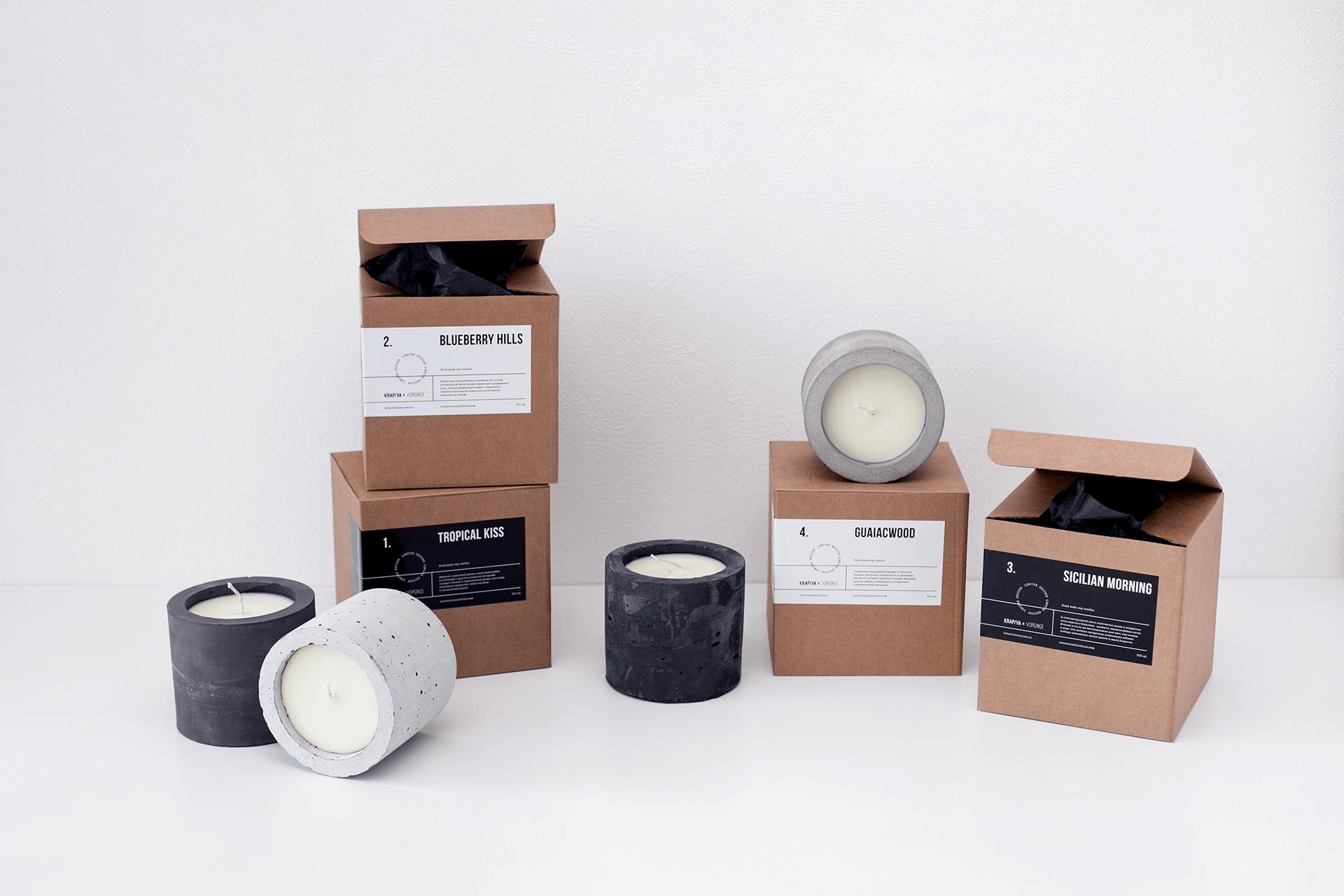 Packaging en carton naturel avec une étiquette noire de Soy Candles