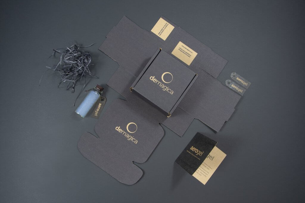 flatlay view of customised dark boxes by demagica
