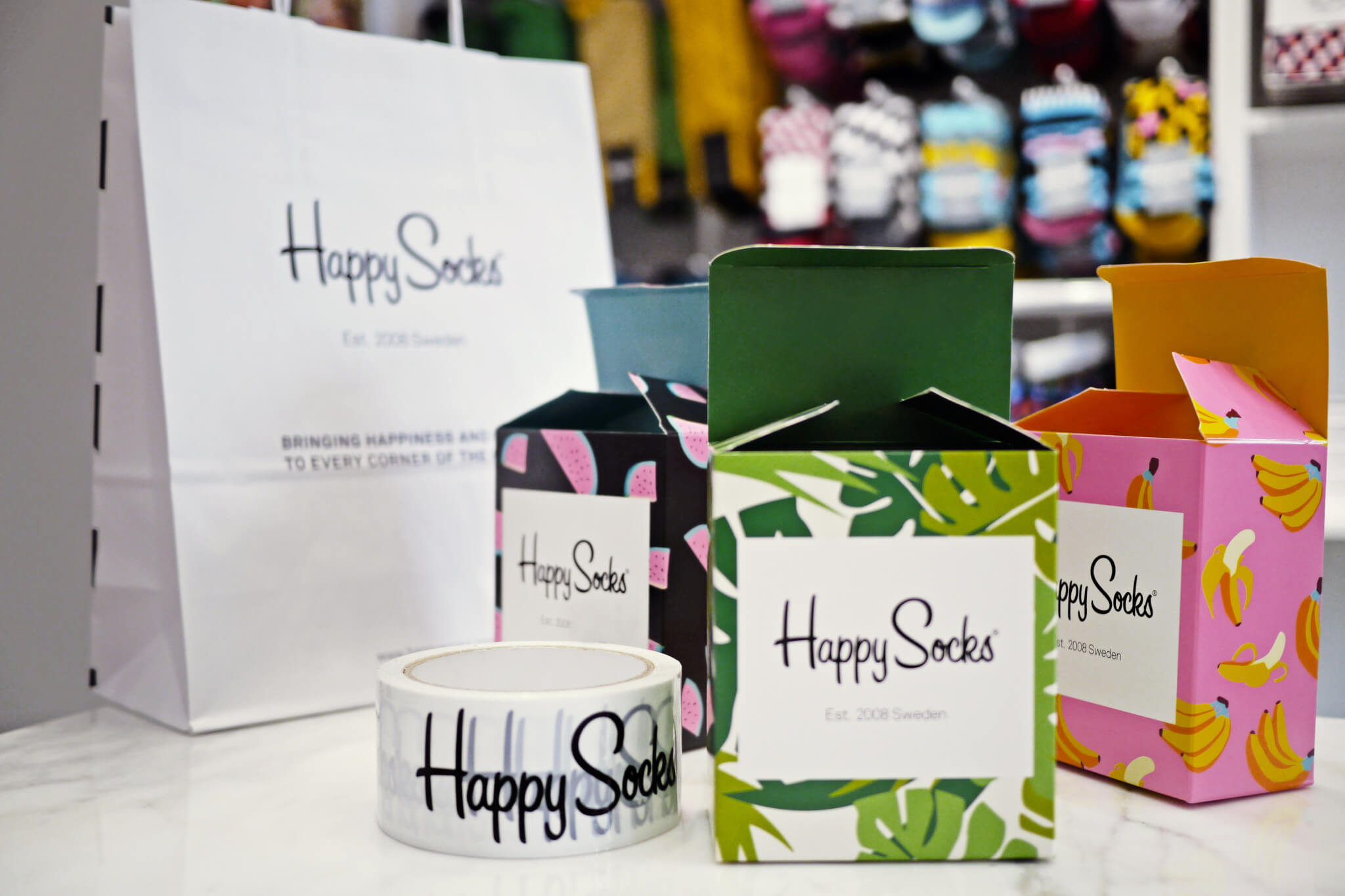 Ensemble de packaging Happy Socks pour son branding
