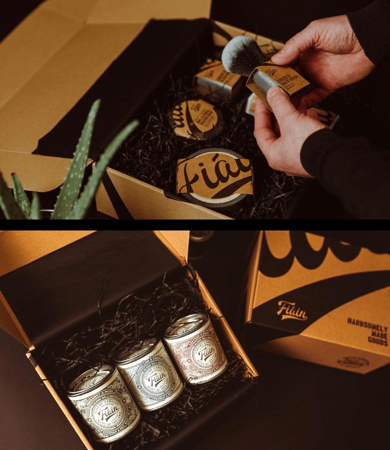 Offene Fiain Verpackung, eine Hand hat ein Produkt aus der Box in der Hand
