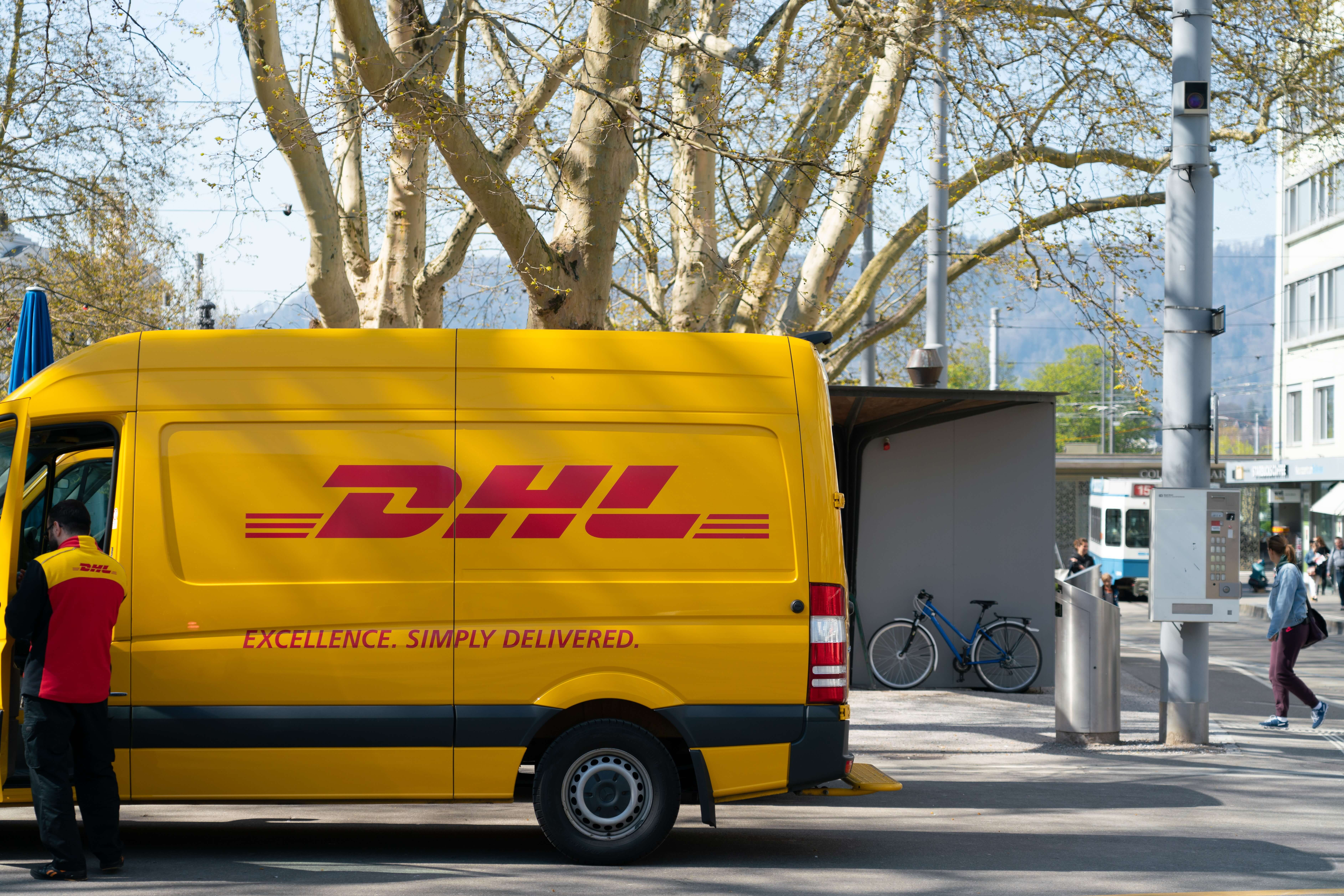 DHL delivery truck and delivery man