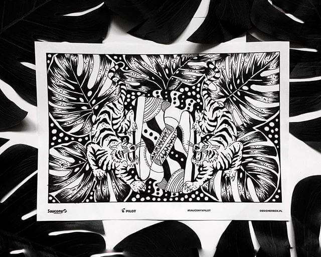 Un diseño blanco y negro de la marca Saucony Originals