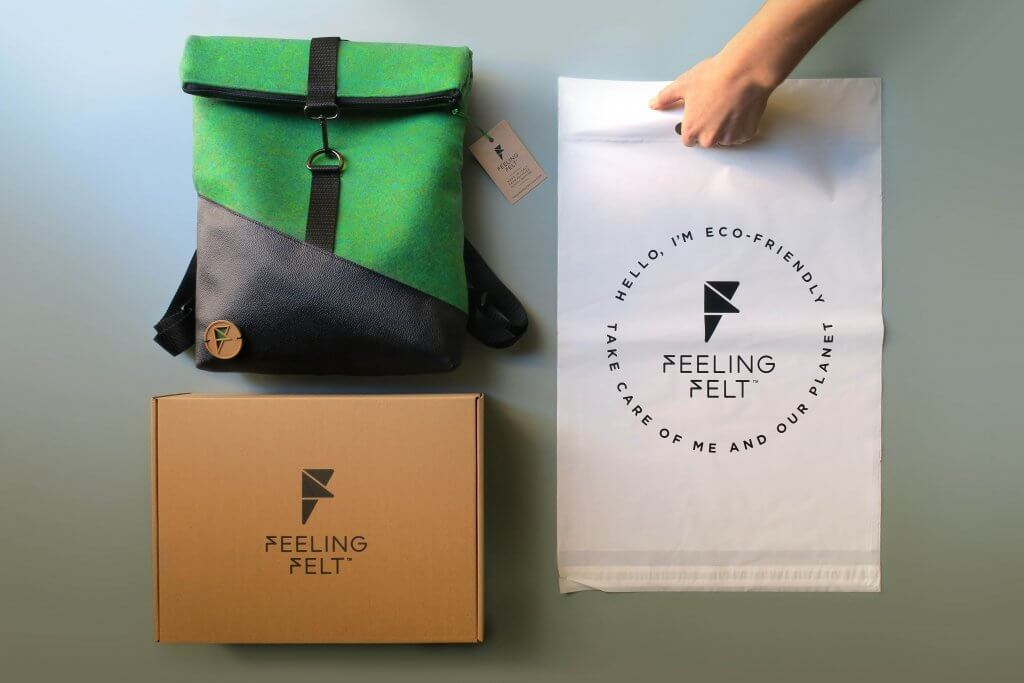 green backpack with an eco mailer box and bio poly mailer