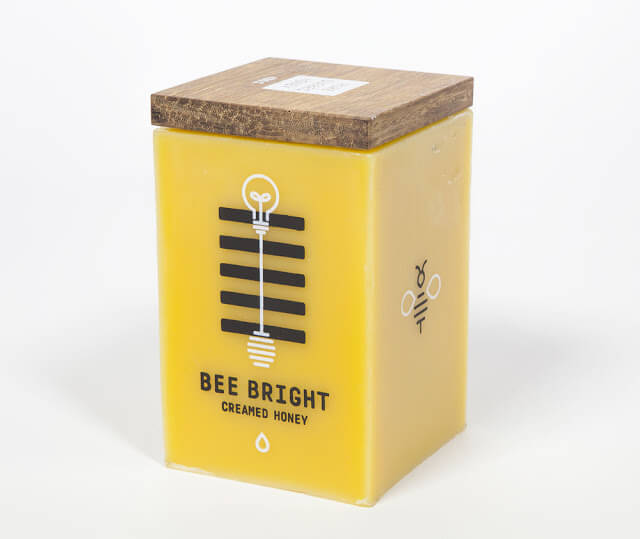 Yellow honey container that converts into a candle