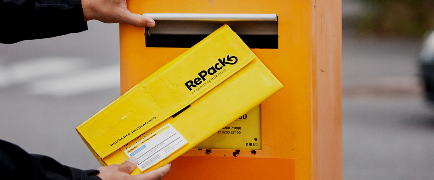 yellow repack packaging put in an orange mail box