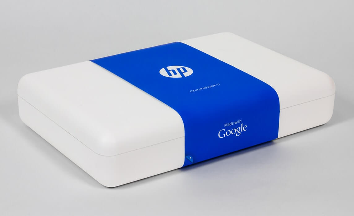 white hp laptop with blue cover