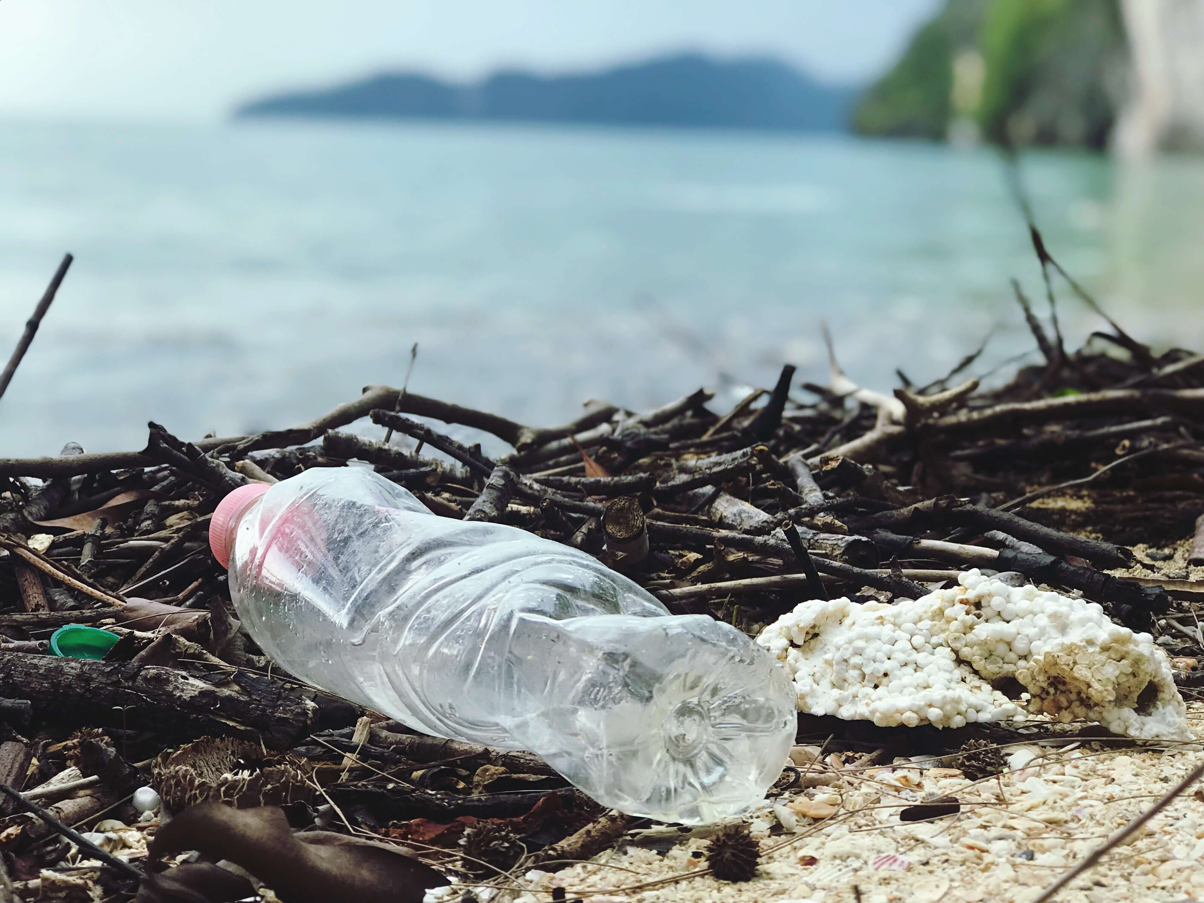 Clear plastic bottle on sandy beach