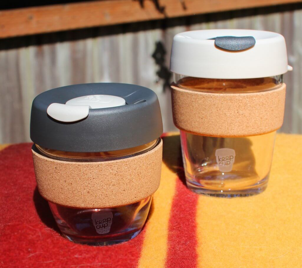keep cup with brown foam handle and rubber lids