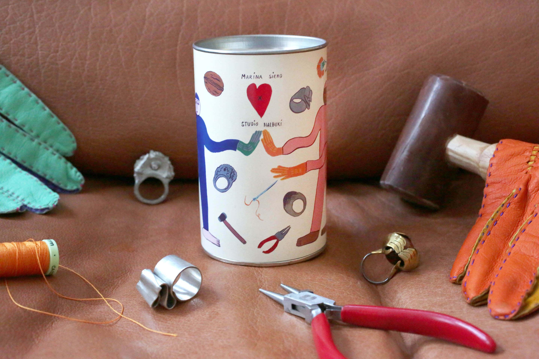 packaging cilíndrico para guardar anillos de metal