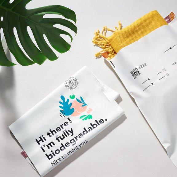 Sacchetto postale compostabile prestampato con pianta
