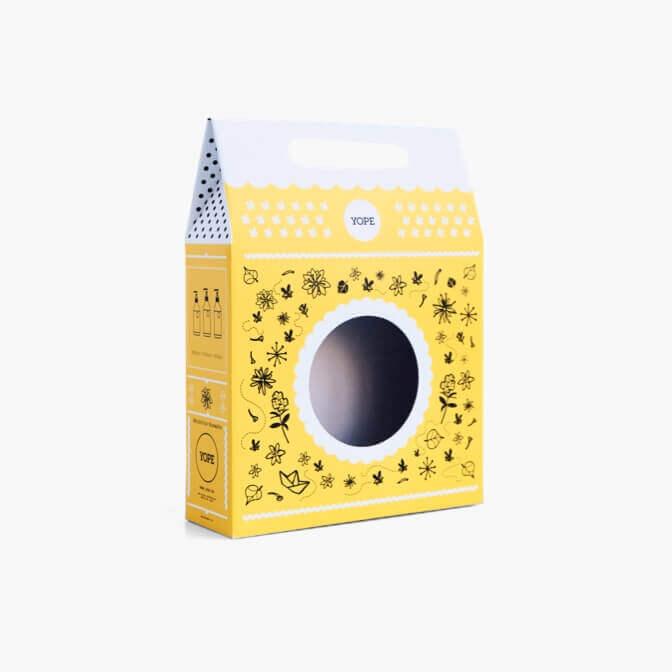 scatola con maniglia bianca e gialla