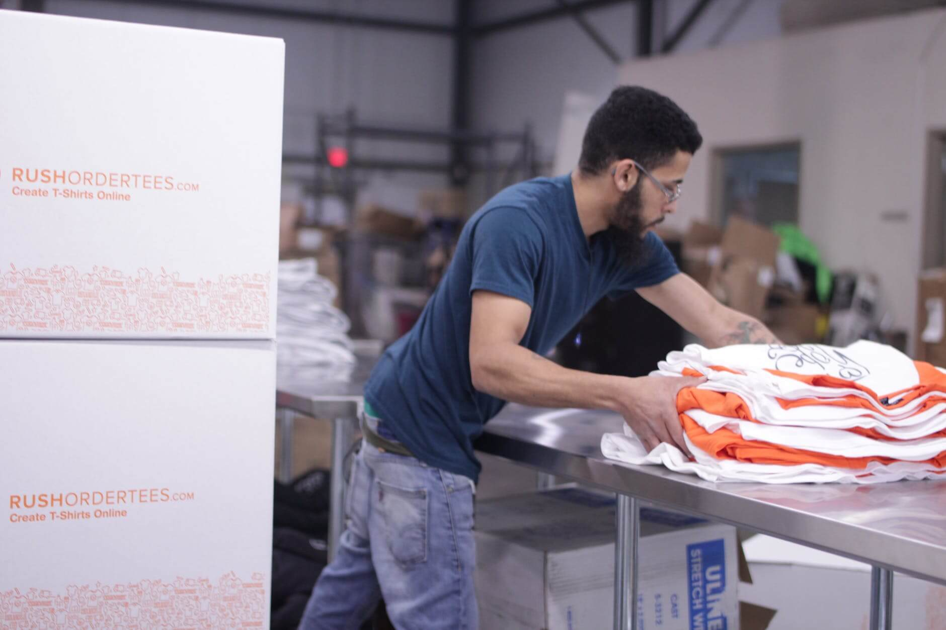 Warehouse worker sorting and packing